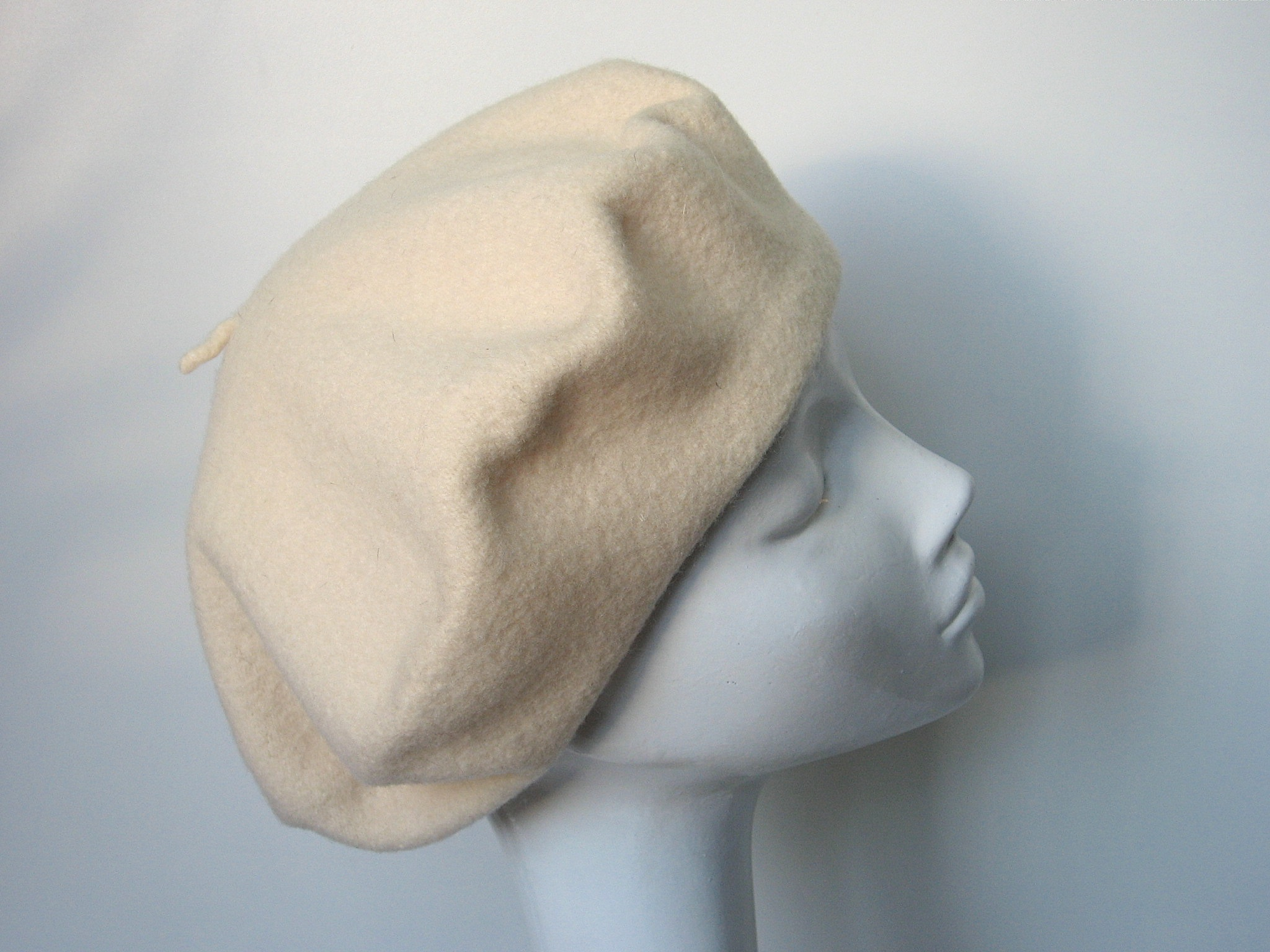 8f57778f2a369 Cream beret by Kangol. 100% pure virgin wool. Made in Great Britain.