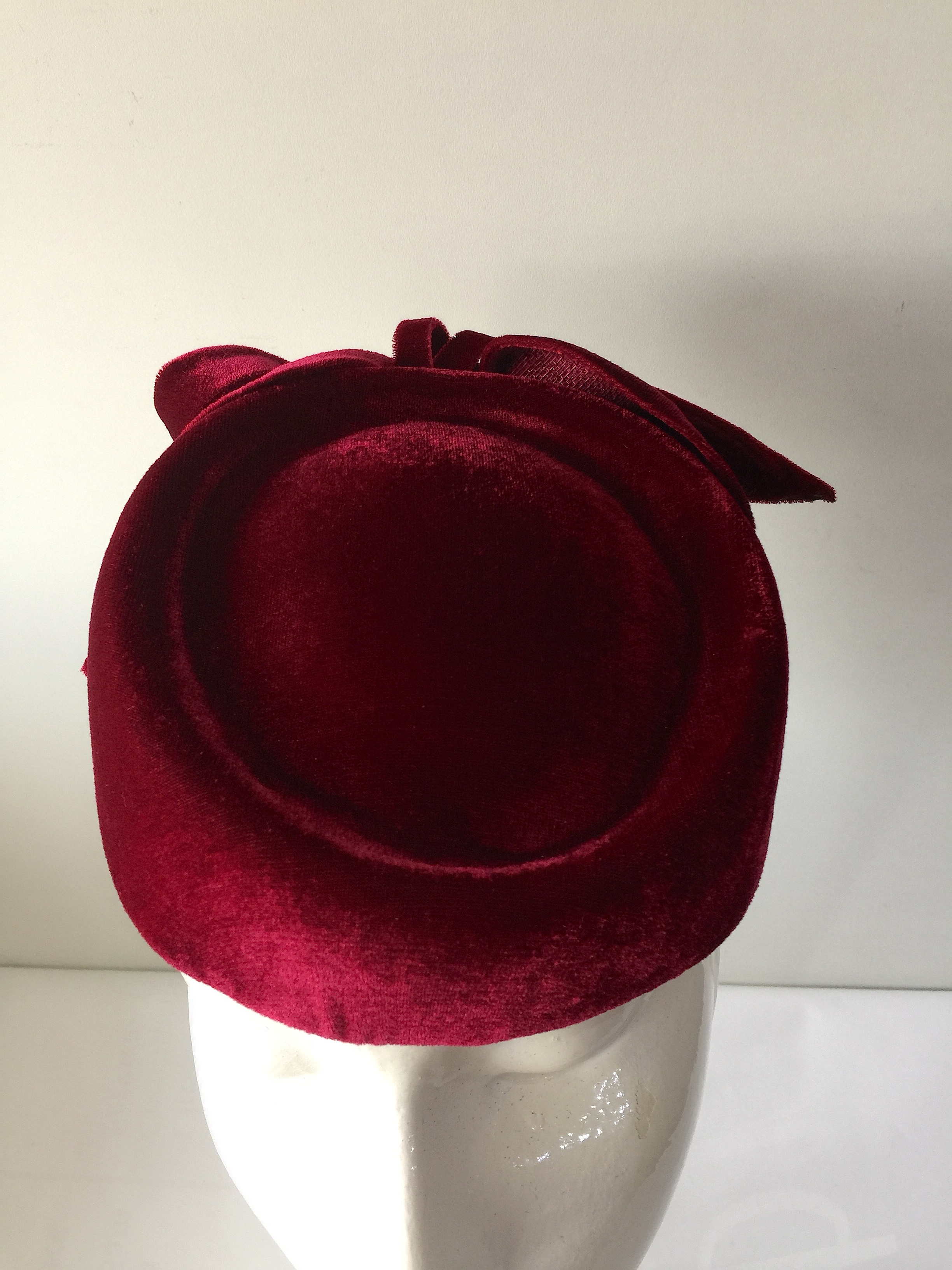 A velvet pillbox hat in morello cherry red with velvet bow trimming. Hat  elastic for a secure fit. 8b68296b8ac