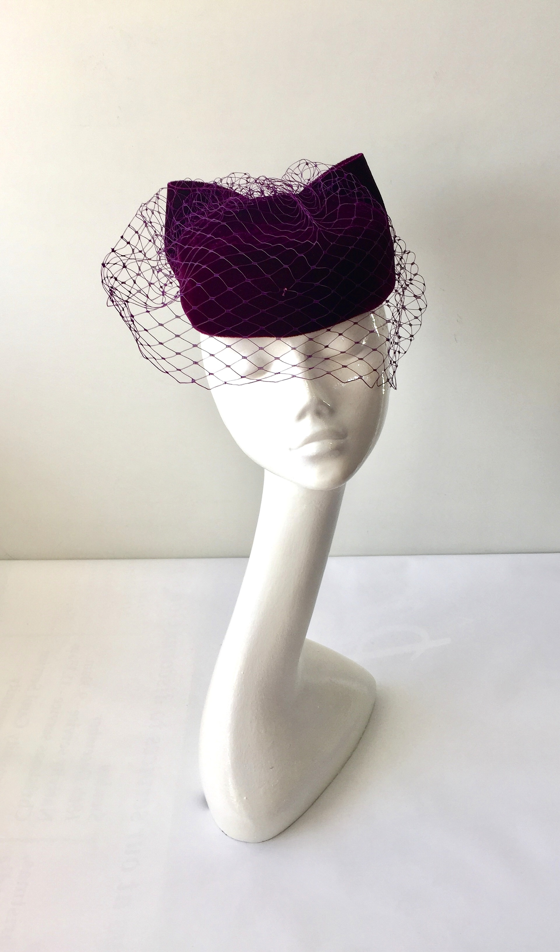 Blackcurrant velvet pillbox hat with merry widow veiling and velvet bow  trim. With hat elastic for a secure fit. ef8bdc12831