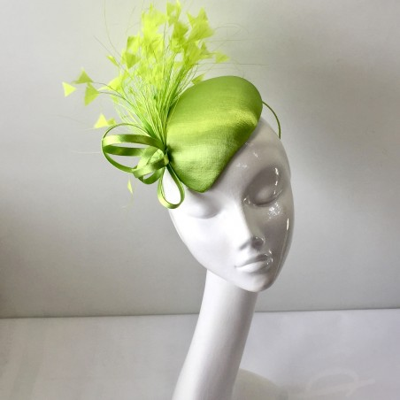 Satin teardrop skull crown fascinator with satin loops and feather trim in lime  green. Set on an alice headband. 98ee916f535